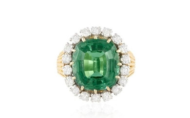 A TOURMALINE AND DIAMOND CLUSTER RING, CIRCA 1955 The cushion-shaped green tourmaline weighing approximately 9.00cts within a surround of brilliant-cut diamonds to a wirework basket gallery, mounted in 18K gold and platinum, diamonds approximately...