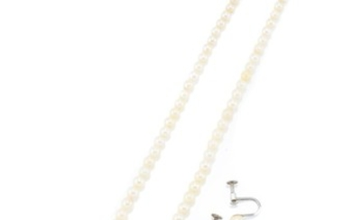 A VINTAGE CULTURED PEARL NECKLACE AND EARRINGS; 3.4-7.1mm graduated cultured pearls to silver clasp, length 44cm, and matched earrin...