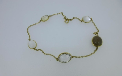 A chain necklace set with five hardstone accents,