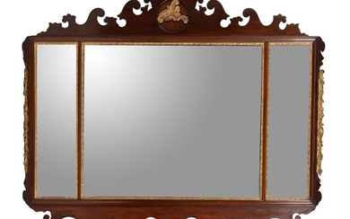 A mahogany and parcel gilt fretwork wall mirror in George II style