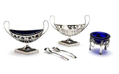 A pair of Dutch silver salt cellars with one glass liner and two spoons