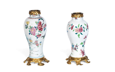 A pair of Louis XV gilt bronze mounted matched Chinese famille rose porcelain garniture vases
