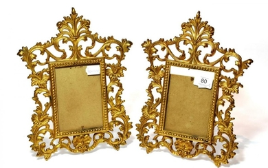A pair of Rococo style scroll cast metal easel back...