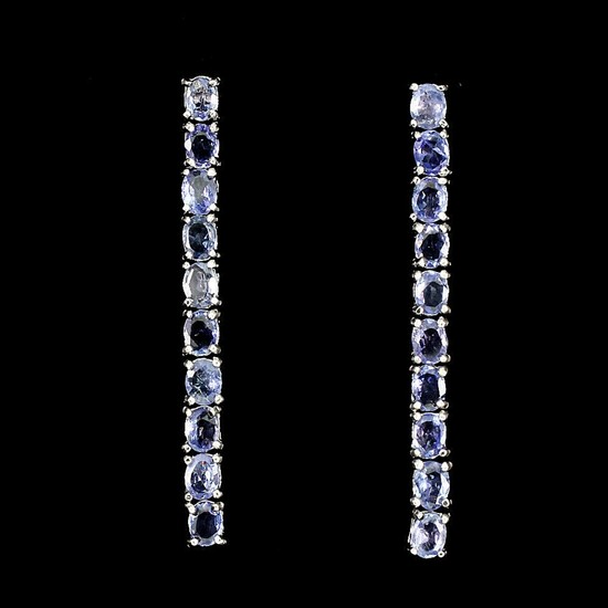 A pair of tanzanite ear pendants each set with numerous oval-cut tanzanites, mounted in rhodium plated sterling silver. L. 4.2 cm. (2)