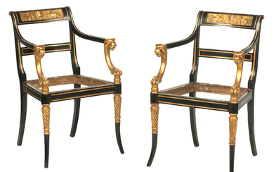 A set of four 19th century ebonised and parcel gilt open armchairs, After a design by George Smith