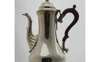 A silver coffee pot, of baluster form, with leaf moulding to...