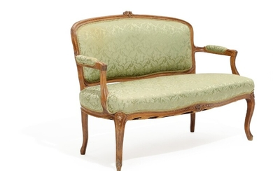 A stained beech Rococo style sofa, carved with foliage. Circa 1900. L. 127 cm.