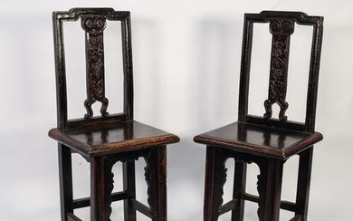 AGED PAIR OF CHINESE CARVED HARDWOOD SINGLE CHAIRS, each wit...