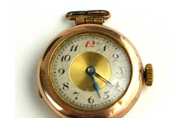 AN EARLY 20TH CENTURY 9CT GOLD RED 12 WATCH No strap.
