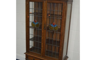 AN EARLY TO MID 20TH CENTURY OAK DOUBLE DOOR BOOKCASE, with ...