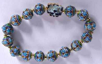 AN ENAMEL BRACELET, formed with floral decorated beads.