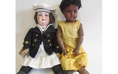 An Armand Marseille bisque socket head black doll, with brow...