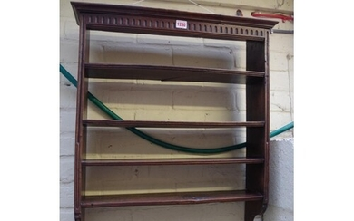 An antique French fruitwood hanging shelf, 61cm wide....
