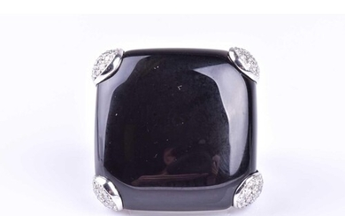 An onyx and diamond dress ring by Gavello, the cushion shape...
