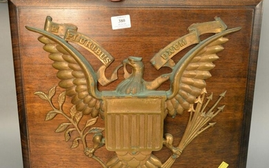 "Bronze eagle plaque ""Pluribus Unum "" on backing, 17"" x"