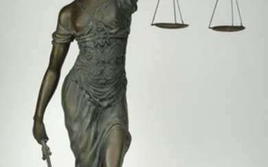 Bronze sculpture of Lady Justice holding her scales