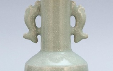 """CHINESE CELADON PORCELAIN MALLET VASE In a white-flecked glaze. Animalistic handles at shoulder. Height 7.5""""."""