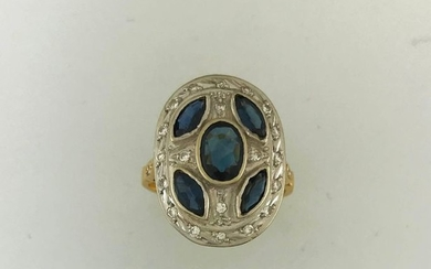 Cushion ring in 750°/°° gold set with sapphires...