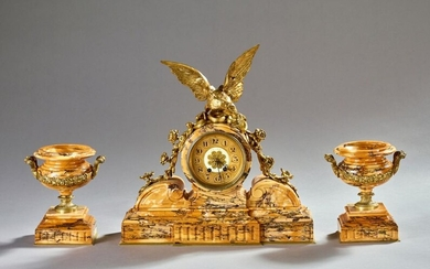 Empire style mantel set in yellow Sienna marble and gilded bronze comprising a clock with an eagle with outstretched wings and a pair of cassolettes.