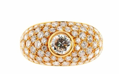 Gold gadrooned ring centered on a brilliant cut diamond of approximately 0.5 carat in a closed setting in a pavé of brilliants totaling approximately 2.5 carats Gross weight: 8.1 g