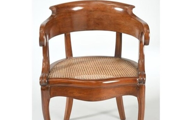 LOUIS PHILIPPE OFFICE FAUTEUIL on a mahogany wickerwork and mahogany veneer background with moving armrests. Slightly curved legs at the front and sabre feet at the back. Ep.XIXth century.