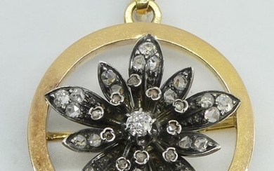 PENDANT that can form a BROCHURE in yellow gold, adorned with a silver flower set with rose-cut diamonds. Partly from the Napoleon III period. Gross weight 10.2 g (missing a small rose in a pistil)