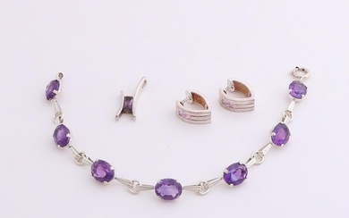 Three silver jewelry with colored stones. A bracelet