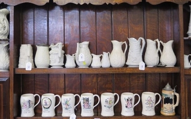 Various Victorian and later relief moulded jugs, all in whit...