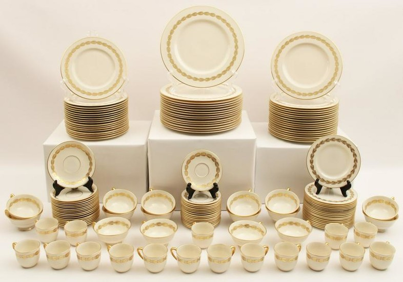 128 + pc. Bone China gold rimmed dinner service by