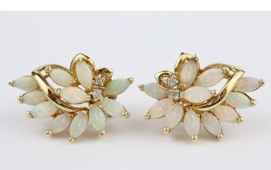 14ct gold opal and diamond earrings. The earrings set with e...