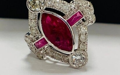 18ct White Gold Ruby and Diamond ring featuring...