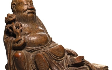 A CARVED BAMBOO FIGURE OF AN IMMORTAL 17TH CENTURY | 十七世紀 竹雕仙人坐像