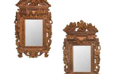 A pair of French Renaissance Style Carved Oak Mirrors,