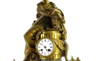 A 19thC French gilt metal figural mantel clock, modelled...