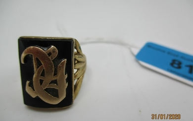 A 9ct gold signet ring with a black tablet and initials, 6.9...