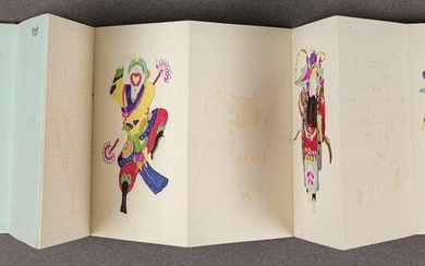 A BOOK OF CHINESE OPERA PAPER CUTS. China, 1955. 14.2 x 9.8 cm. Accordion-folded book with 12 pages. Brocade-covered front and back panels.