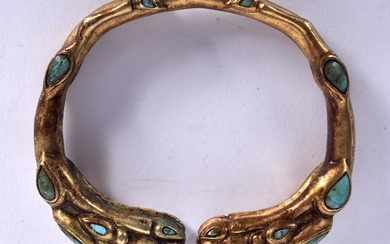 A CHINESE SINO TIBETAN YELLOW METAL BANGLE, formed with