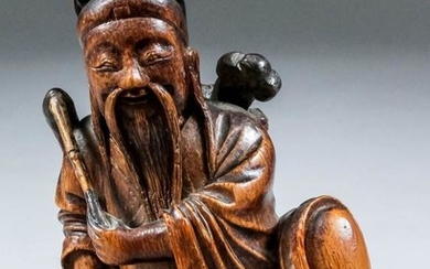 A Chinese carved and stained bamboo seated figure of...