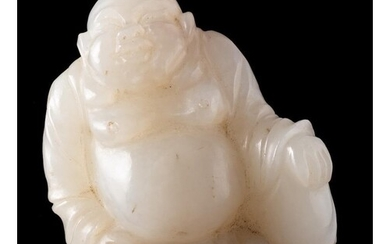 A Chinese jade carving of Budai: the stone of pale celadon c...