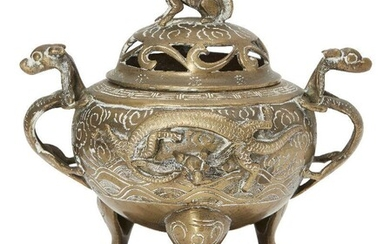 A Chinese polished bronze censer and cover, 19th century, modelled...