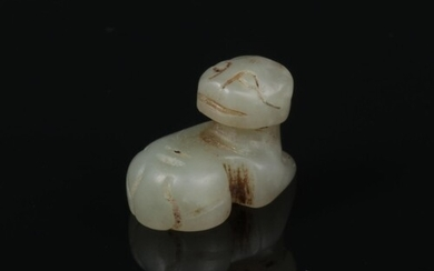 A Chinese tiny pale celadon jade model carved as a seated ca...