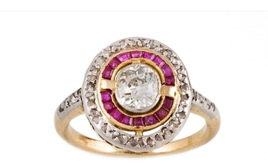 A DIAMOND AND RUBY TARGET CLUSTER RING, the central oval cut...