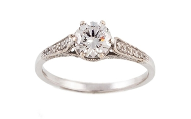 A DIAMOND SOLITAIRE RING, one round brilliant cut diamond of...