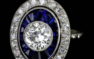 A Diamond and Sapphire Halo Ring, Modern, in 18ct...