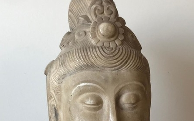 A Marble Head of Buddha.