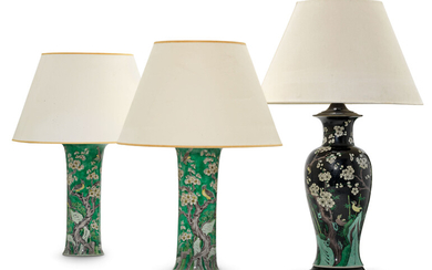 A PAIR OF CHINESE FAMILLE VERTE BEAKER VASES AND A CHINESE FAMILLE NOIRE BALUSTER VASE, MOUNTED AS LAMPS, 19TH/20TH CENTURY
