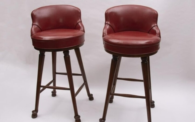 A Pair of Red Leather Upholstered Swivel Bar Stools