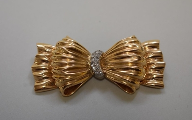 A Tiffany & Co gold and diamond set bow brooch, stamped ...