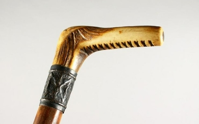 A VICTORIAN ANTLER-HANDLED WALKING STICK with silver