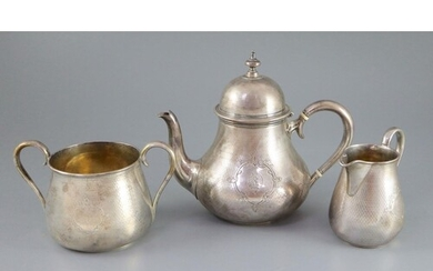 A Victorian engine turned silver three piece tea set by Rich...
